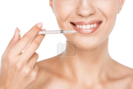 Woman making beauty injection