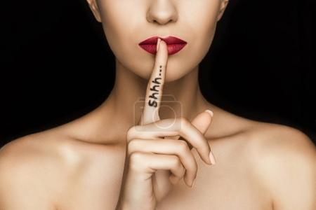 woman with shh symbol