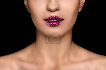 fashionable woman with sparkles on lips