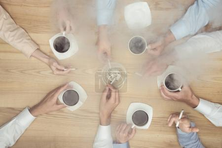businesspeople smoking on coffee break