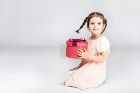 adorable girl with present