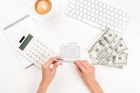 businesswoman and dollar banknotes at workplace