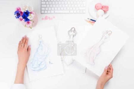 fashion designer working with sketches