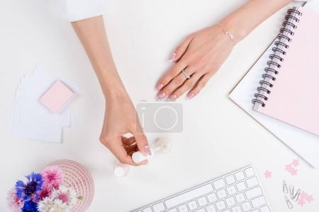 woman doing manicure at workplace