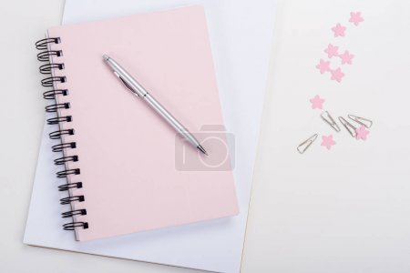 Photo for Top view of pen on pink notebook and office supplies at workplace - Royalty Free Image