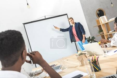 Businessman making presentation for colleagues