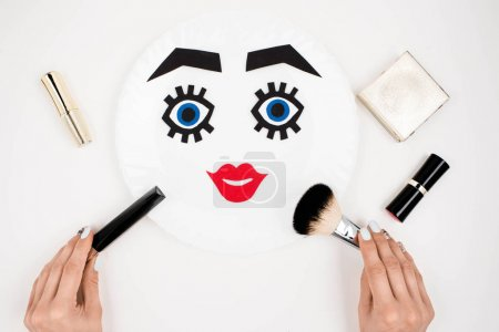 paper face with makeup on plate