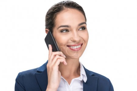 Photo for Beautiful smiling businesswoman in suit using smartphone, isolated on white - Royalty Free Image