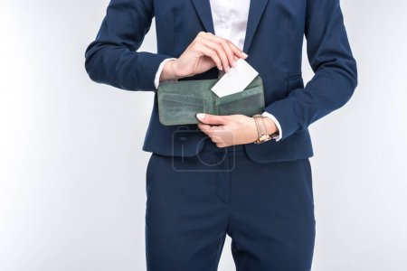 Photo for Cropped view of businesswoman holding wallet with credit card, isolated on white - Royalty Free Image