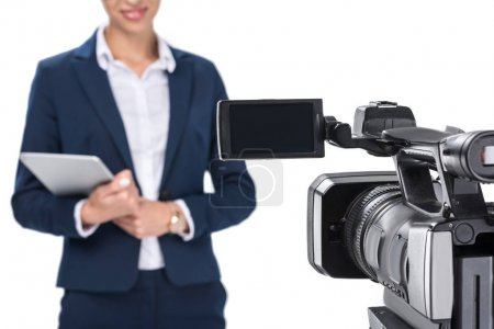 newscaster standing in front of camera
