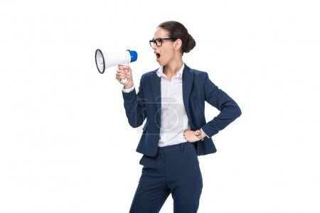 Photo for Beautiful angry businesswoman yelling and holding megaphone, isolated on white - Royalty Free Image