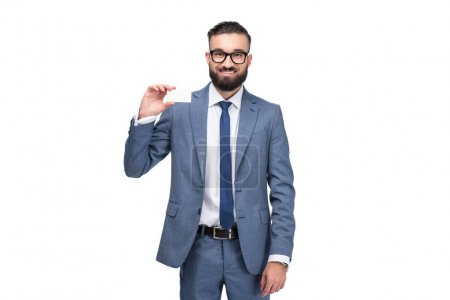 Photo for Handsome smiling businessman holding empty business card, isolated on white - Royalty Free Image