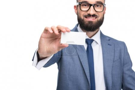 Businessman holding empty business card