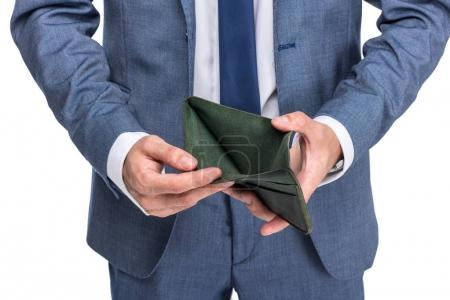 Photo for Cropped view of businessman holding empty wallet, isolated on white - Royalty Free Image