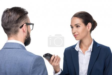 journalist taking interview with businessman