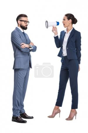 Photo for Attractive angry businesswoman with megaphone screaming on her male coworker, isolated on white - Royalty Free Image
