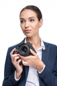 businesswoman holding professional camera