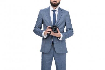 businessman holding camera