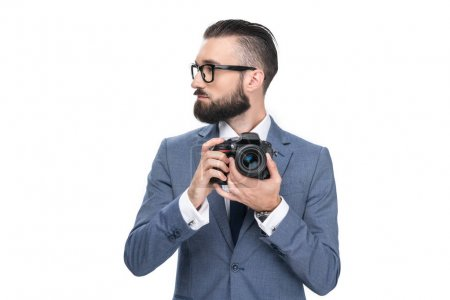 businessman holding camera