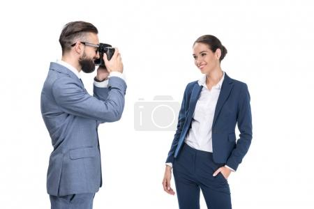 Photo for Man taking photo of beautiful smiling businesswoman, isolated on white - Royalty Free Image