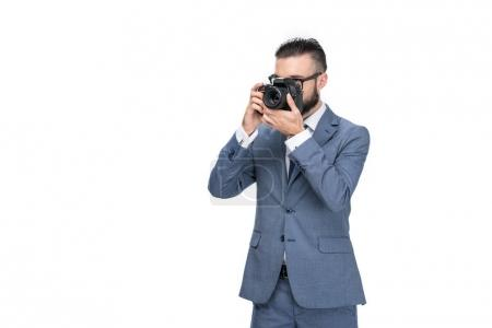 businessman taking photo on camera