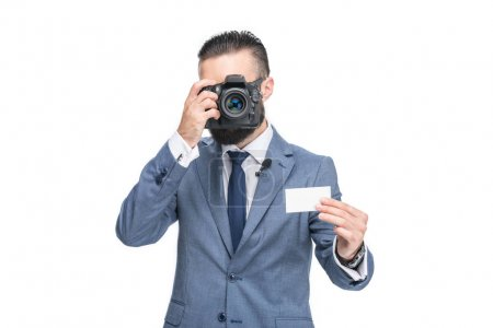 businessman taking photo of card