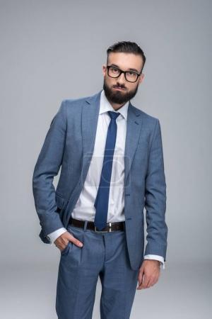 confident businessman posing in suit