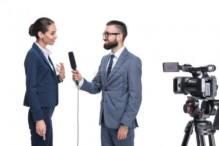 journalist interviewing a businesswoman