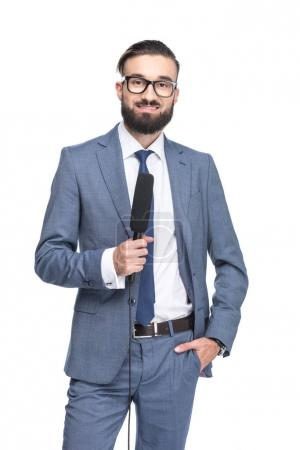 anchorman holding microphone