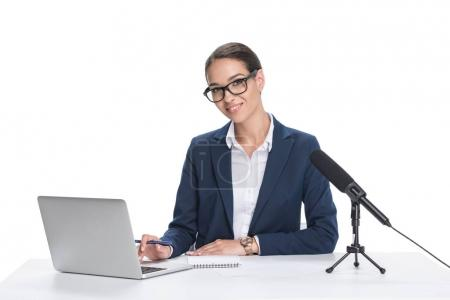 newscaster with laptop and microphone