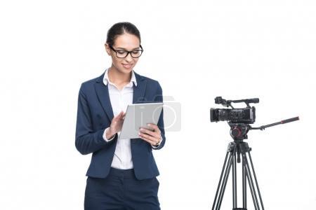 television reporter using digital tablet