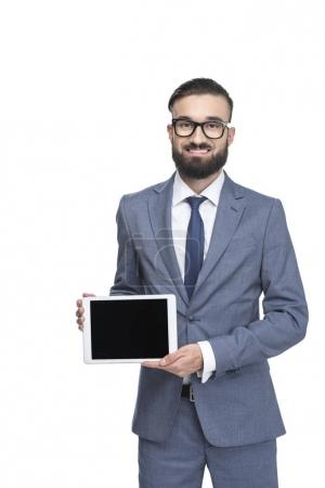 Photo for Businessman presenting digital tablet with blank screen, isolated on white - Royalty Free Image