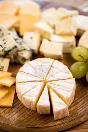 various cheese types and grapes