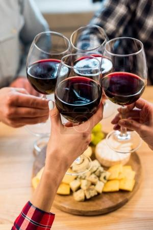 friends clinking glasses of wine