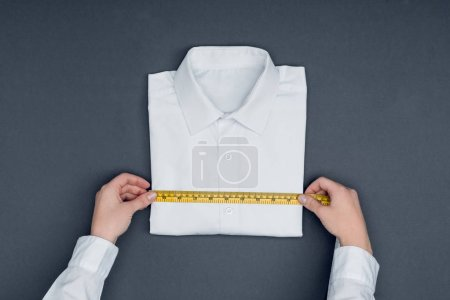 Tailor measuring shirt