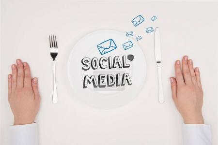 Photo for Top view hands with cutlery and Social media concept on white plate - Royalty Free Image