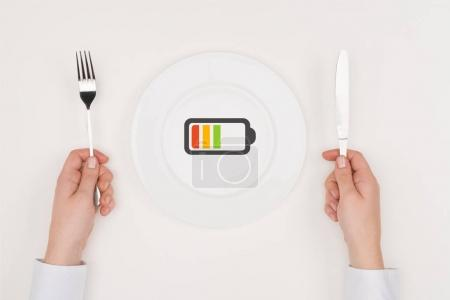 Charging battery icon on plate