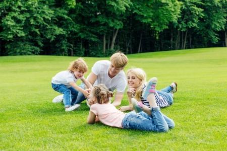 happy family resting in park