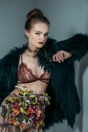 fashionable model in fur coat