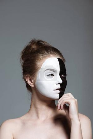 girl with bodyart on face