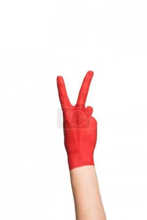 mano que muestra el símbolo de paz