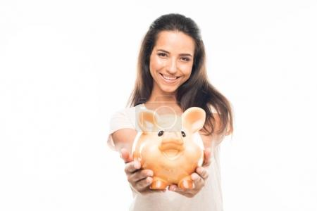attractive woman with piggy bank