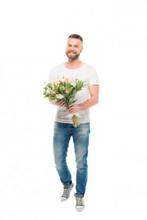 bearded man standing with bouquet