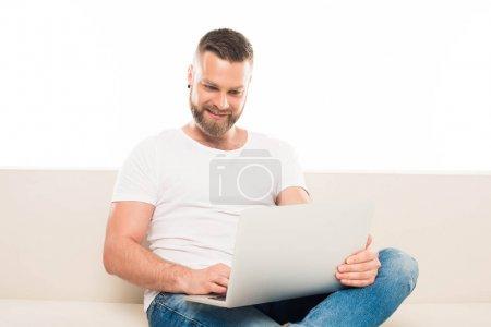 Attractive man using laptop