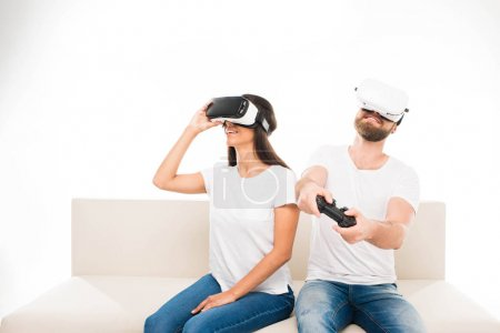 Couple using virtual reality headsets
