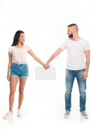 young attractive couple holding hands