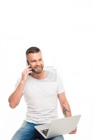 attractive man using smartphone