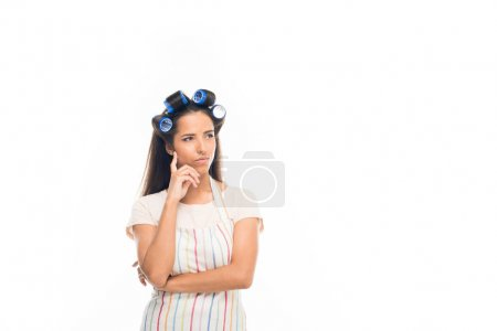 thoughtful housewife with curlers