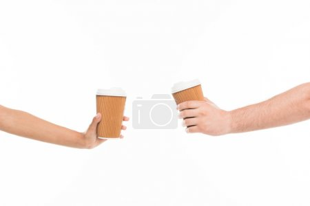hands holding disposable cups
