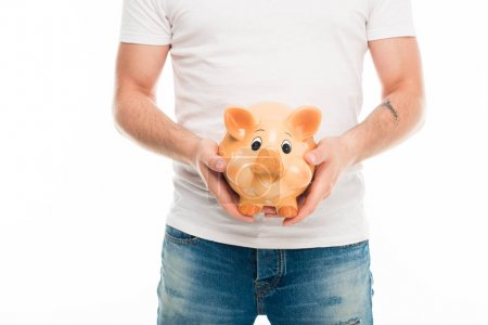 Handsome man with piggy bank